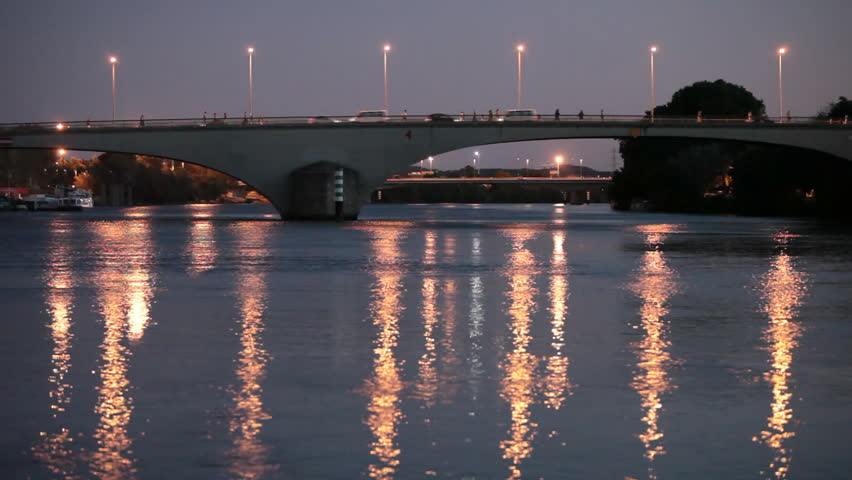 Bridge at dusk - Bridge over a large river with lots of movement on it - people, cars everybody seems to be in a rush