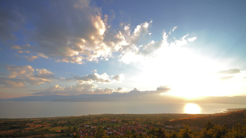 4K sunset beautiful summer landscape with cloudy sky and natural lake, time-lapsed wide shot from day to night