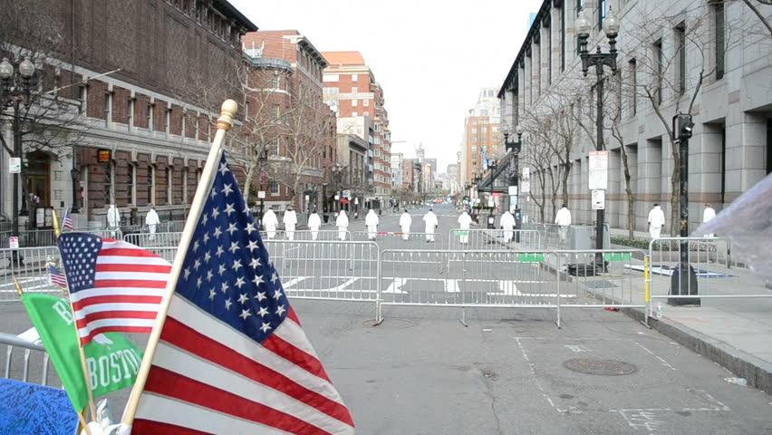 BOSTON - APR 20: Investigators on Boylston Street in Boston,USA on April 20,2013. More 23300 runners take part in Marathon. 3 people killed, over 100s injured on April 15,2013.