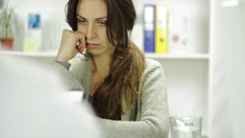 Young Woman at Doctors Office Worried Upset Alarming News