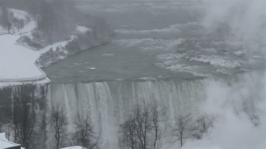 American Falls viewed from the Canadian side in winter.  It is one of the three waterfalls that make up Niagara Falls | Shutterstock HD Video #5415011