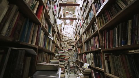 Corridor of library with wood bookcases with many forgotten books