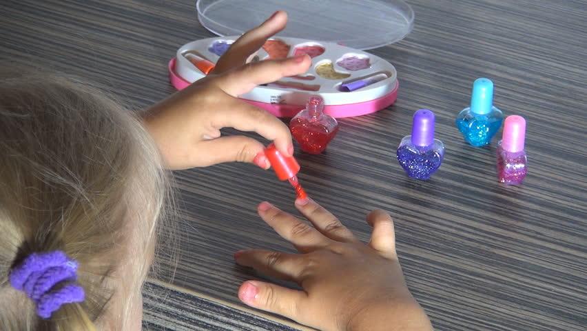 Stock video of beautician applying nail polish to kid's ...