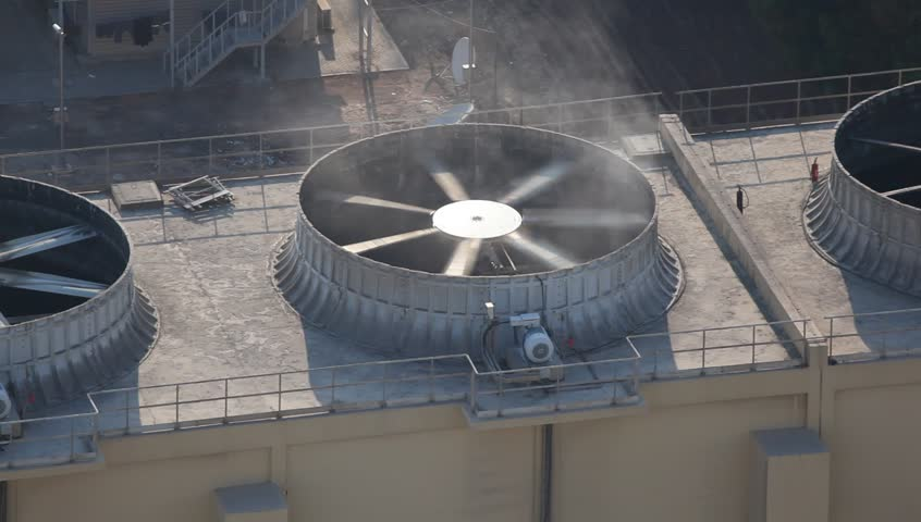 Big commercial air conditioner on top of a residential building