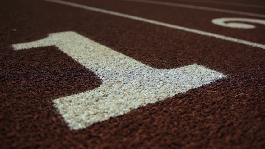 Slow dolly of a number 1 on a running track. | Shutterstock HD Video #5451371