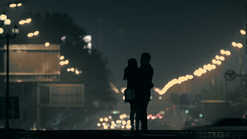 Embracing couple in the night,Beijing,China.