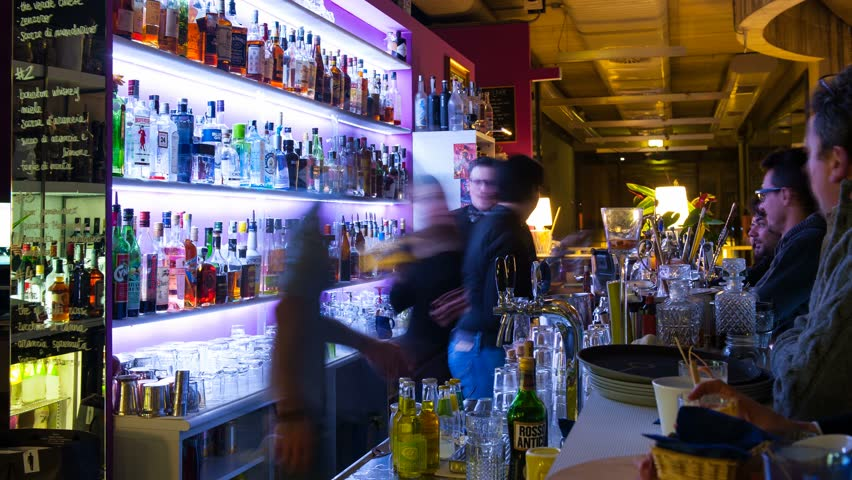 BOLOGNA, ITALY - JANUARY 15, 2014: Time lapse of people in Be Towers bar in Budrio, Bologna, Italy. This is the most famous bar in Budrio and young boys came from all over the city to its parties.