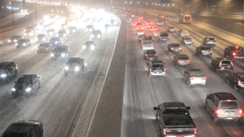 Traffic on highway during winter snow storm 1920x1080