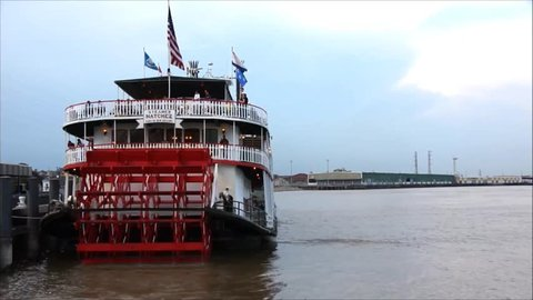 New Orleans - July 13: Steamboat Natchez departs on its daily cruise up the Mississippi River on July 13th, 2011. The Natchez is the last authentic steamboat in operation on the river.