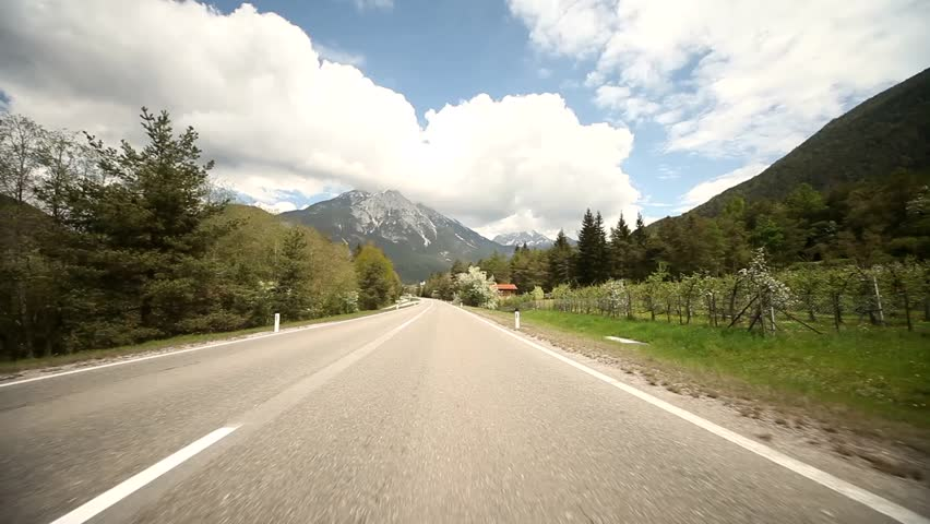 Video footage of driving on a highway in the alps in austria | Shutterstock HD Video #5478893