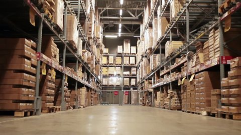 Moving camera along storehouse of goods in wholesale shop