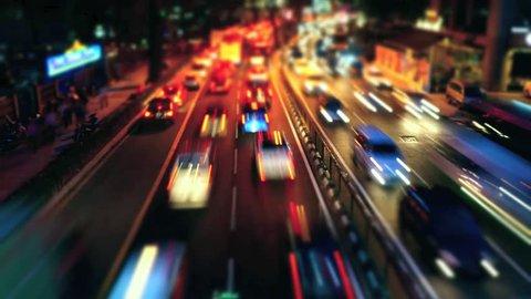 KUALA LUMPUR, MALAYSIA - NOVEMBER 8: Time Lapse of busy traffic at night on a road in Jalan Ampang in Kuala Lumpur, Malaysia on 8 November 2013