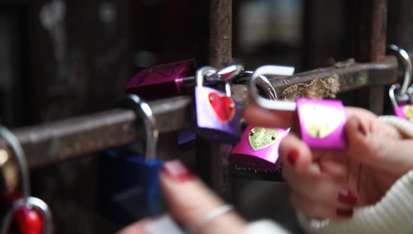 tourist declaring her love on a lock in the House of Romeo and Juliet in verona