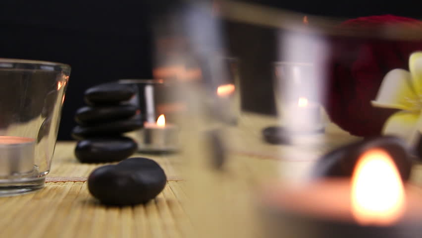 Spa therapy stones surrounded by candles | Shutterstock HD Video #5492891