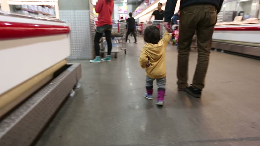 Baby Toddler At The Store 4 4) Glidecam video shot of baby Korean toddler in a big warehouse store with uncle.