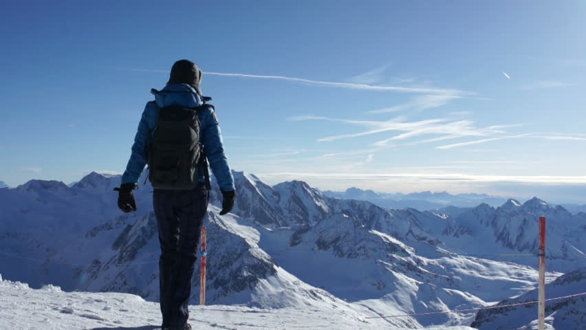 Woman standing on mountain peak with arms outstretched, Hintertux glacier,Tirol, Austria  #5568251
