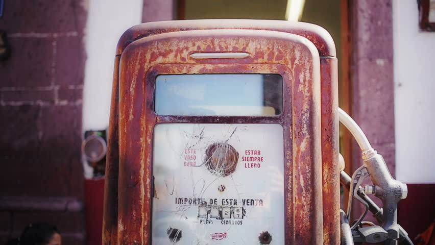 Detail of an old gas pump in square town