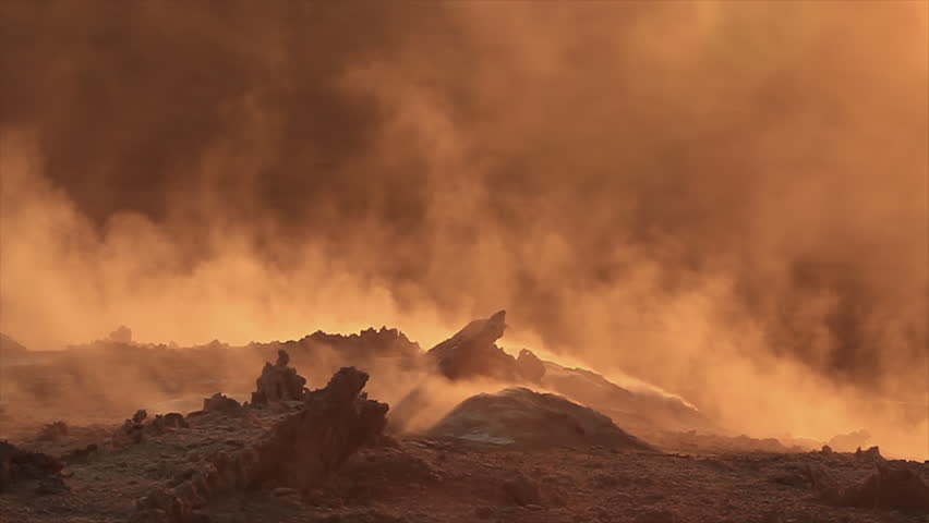 Martian terrain, acid fumes in backlight, volcanic rocks. Geothermal area, Iceland. Slow motion: shot at 60fps, conformed to 25fps, it can be interpreted at any fps from 24 to 60fps. Codec: ProRes