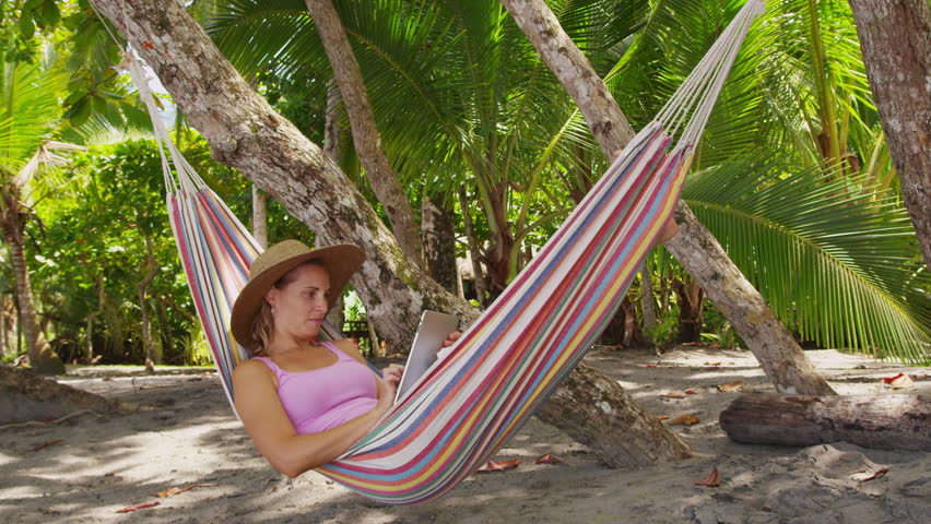 woman sitting in hammock using digital tablet costa rica  shot on red epic for man sitting in hammock using laptop  puter costa rica  shot on      rh   shutterstock