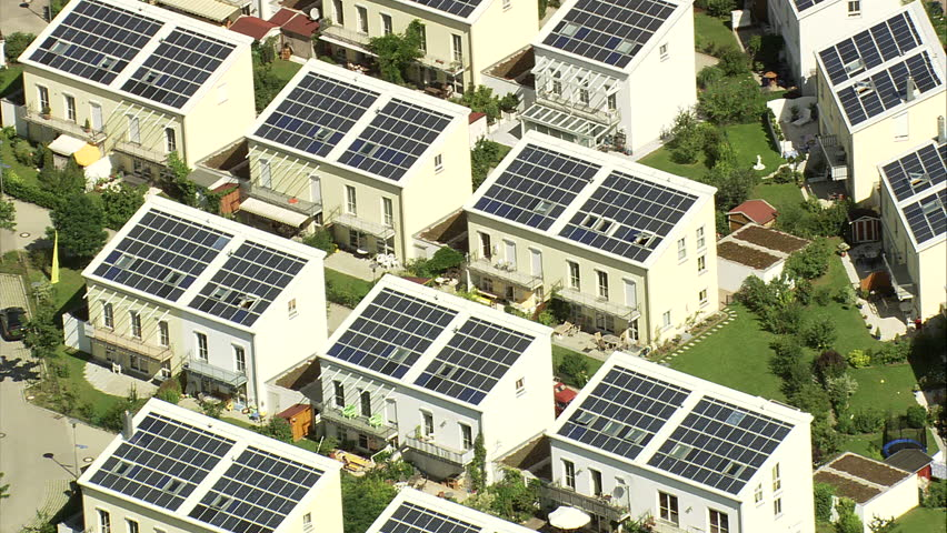 Houses with solar power panels in Germany - Estate with solar panels on roofs of houses in Germany | Shutterstock HD Video #5601917