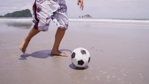 Man kicking soccer ball at beach, Costa Rica. Shot on RED EPIC for high quality 4K, UHD, Ultra HD resolution.