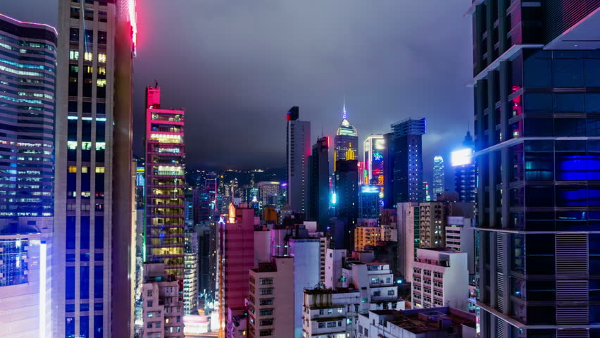 City Night Timelapse. 4K Zoom In Shot. Attractive Hong Kong night timelapse. Commercial office buildings, commercial LED flashing billboards and residential buildings. Fast moving cloud on the sky.  | Shutterstock HD Video #5615291