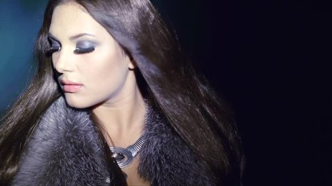 Beauty Fashion Model Girl in Fur Coat. Beautiful Woman in Luxury Silver Fox Fur Jacket. Waistcoat. Winter Fashion. Fashion Makeup. Blowing Hair in the snow. Slow motion shot 240 fps
