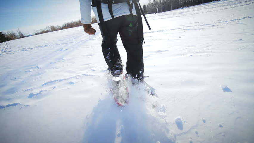 Epic Closeup of Woman Snowshoeing on a Beautiful Winter Day
