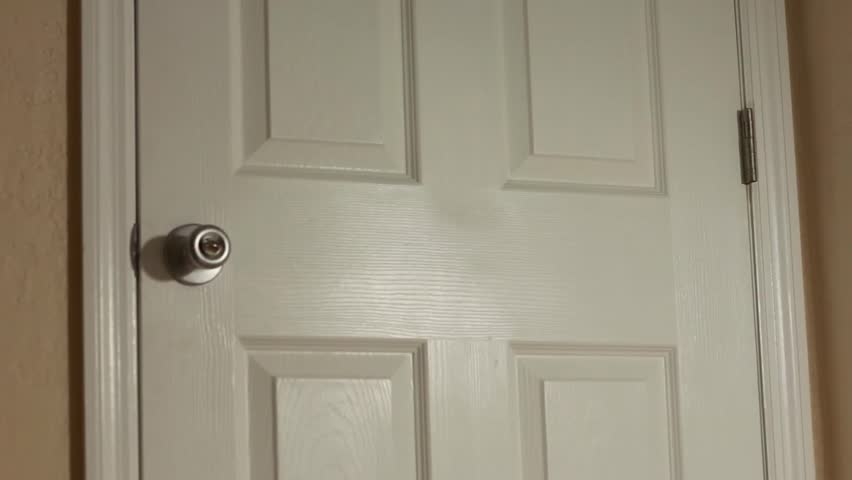 Doorknob turning and door opening by itself | Shutterstock HD Video #5642804