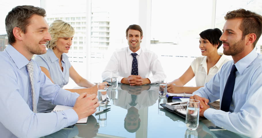 Business people shaking hands during a meeting in the office | Shutterstock HD Video #5658413