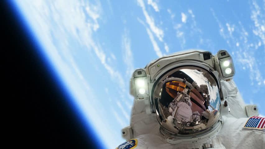 a 70 kg astronaut in space walking outside - photo #9