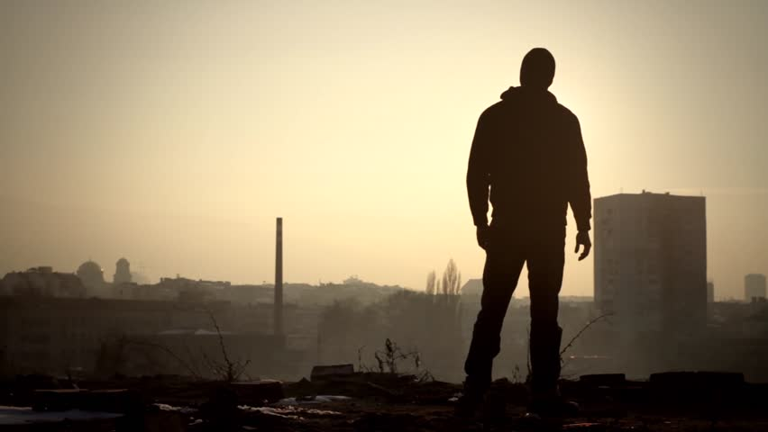 Sad Silhouette Man Standing on Edge Roof Suicide Concept   Shutterstock HD Video #5687486