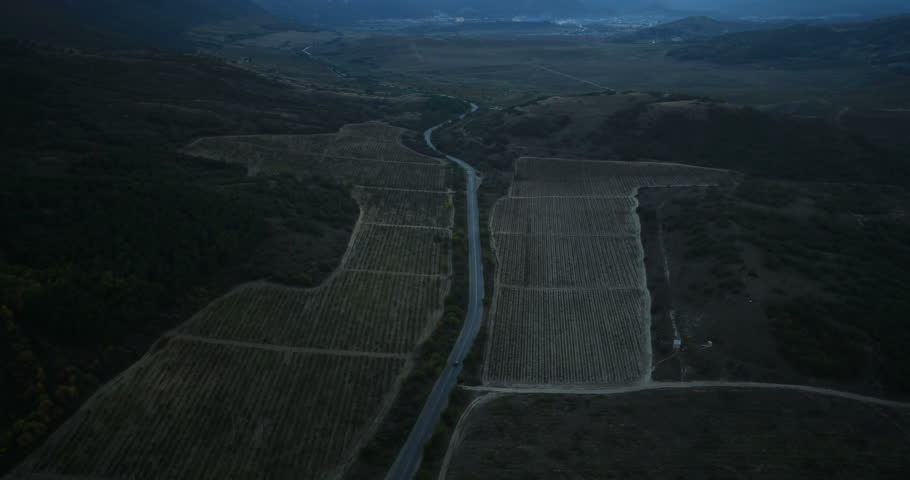 Aerial View: Night drive. Kara Dag Mountain area. Crimea, Ukraine. Summer 2013.