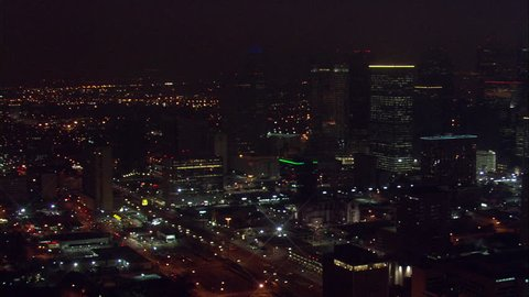 Houston Buildings at Night. A beautiful aerial view of Houston's towering buildings and its main event stadium, the Toyota Center.
