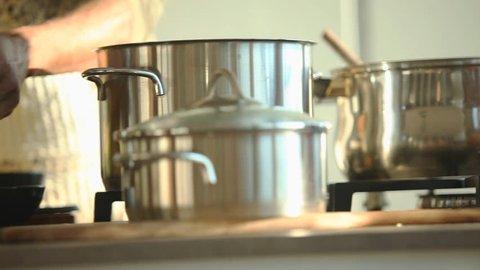 multiethnic couple preparing food in their kitchen
