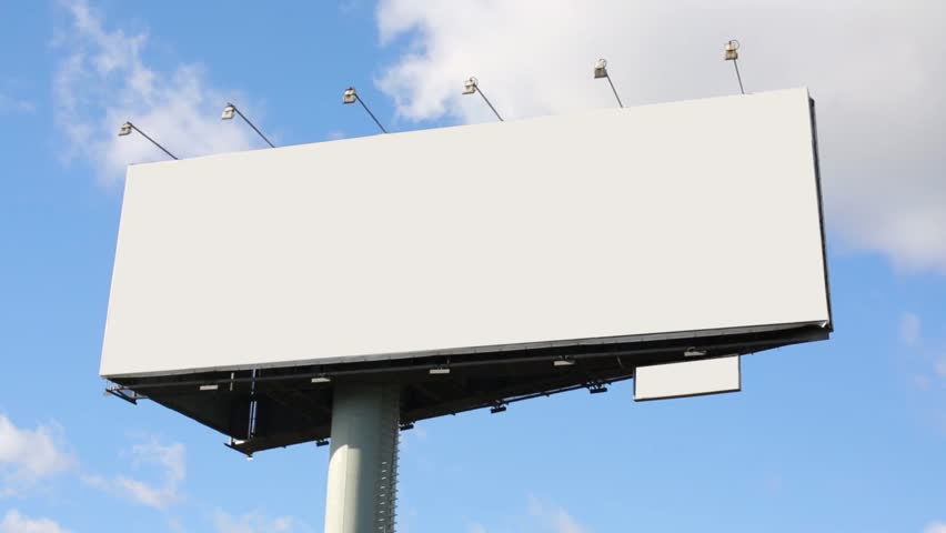 Blank billboard at background of blue sky with moving clouds