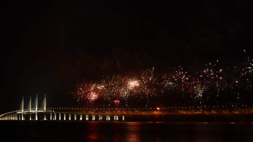 PULAU PINANG, MALAYSIA - MARCH 1, 2014: Firework show during the opening ceremony of the Penang Second Bridge or the Sultan Abdul Halim Muadzam Shah Bridge, which is longest bridge in Southeast Asia.