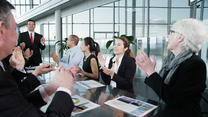 Diverse, happy business team in a meeting in contemporary office building | Shutterstock HD Video #5763761