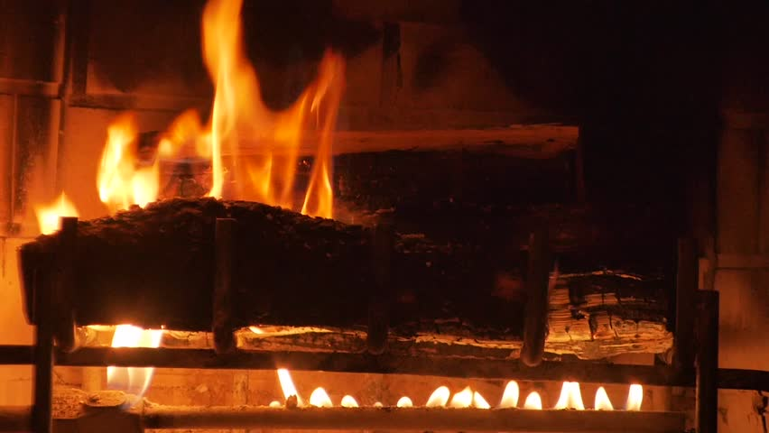Wide Shot Of A Yule Log Burning In A Fireplace. Stock Footage ...