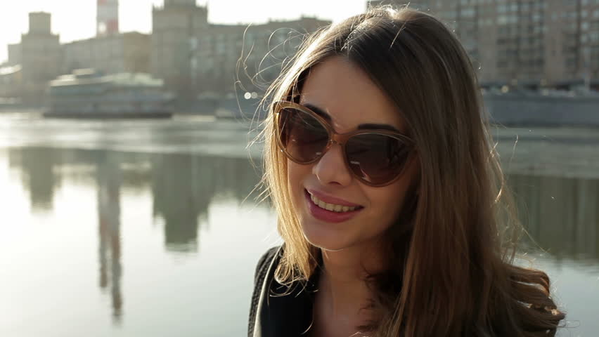 Close-up of beautiful caucasian young woman at the city