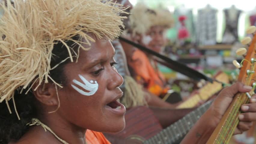 NOUMEA, GRANDE TERRE/NEW CALEDONIA - FEBRUARY 06, 2014: Unidentified Kanak people of Noumea, New Caledonia playing music for tourists