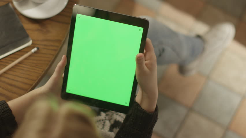 Girl Using Tablet PC with Green Screen. Shot on RED Digital Cinema Camera in 4K (ultra-high definition (UHD)), so you can easily crop, rotate and zoom. Easy for tracking and keying. ProRes HQ codec.  | Shutterstock HD Video #5793350