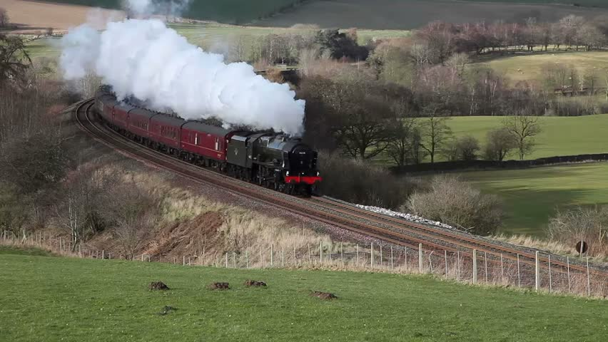 ARMATHWAITE, ENGLAND - MARCH 1:  Preserved steam locomotive Scots Guardsman heads the Winter Cumbrian Mountain Express through Armathwaite on March 1, 2014, on the Settle to Carlisle railway.