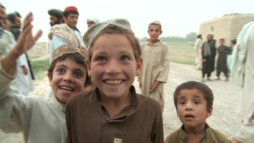 Afghanistan, Circa 2008: Afghan children smile and play to the camera in Afghanistan, Circa 2008
