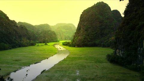 Vietnam river landscape and rice fields panoramic view Ninh Binh. Asia travel landmark destination HD video footage