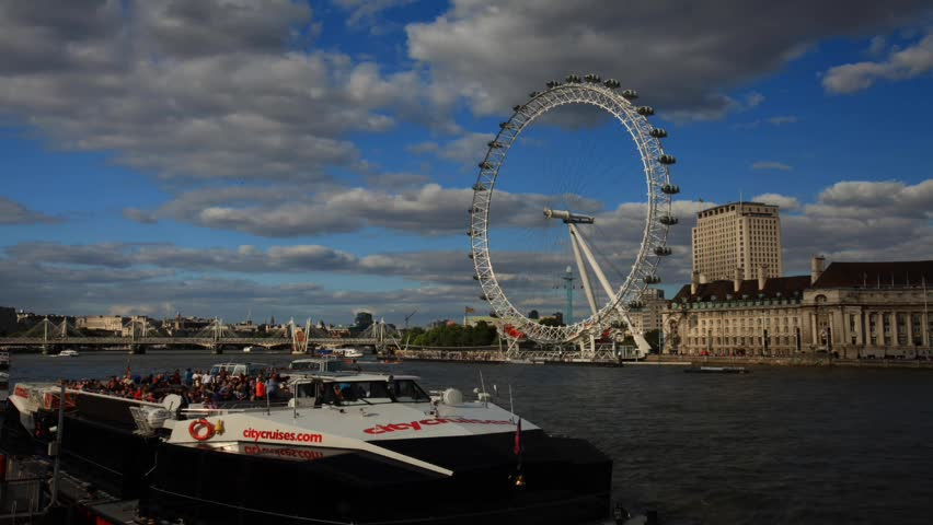 London skyline with London Eye and Westminster on Thames river in a cloudy day | Shutterstock HD Video #5869661