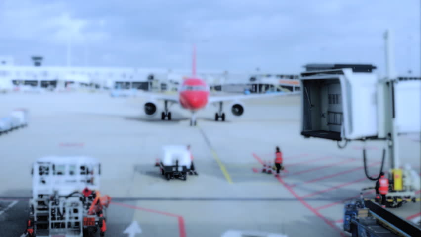 a plane arrives at its docking in zurich airport (speeded up)