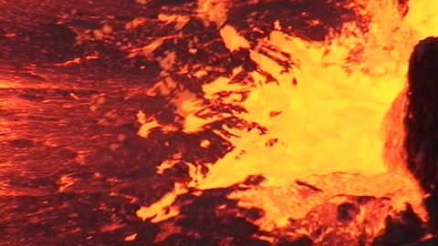Close view to an eruption in the Erta Ale volcano lava lake