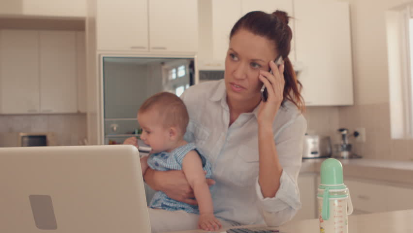 Mother holding baby and talking on phone in slow motion | Shutterstock HD Video #5916836