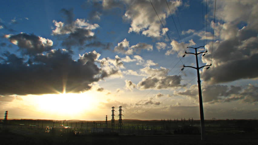 Sun and clouds over power station, HD time lapse clip